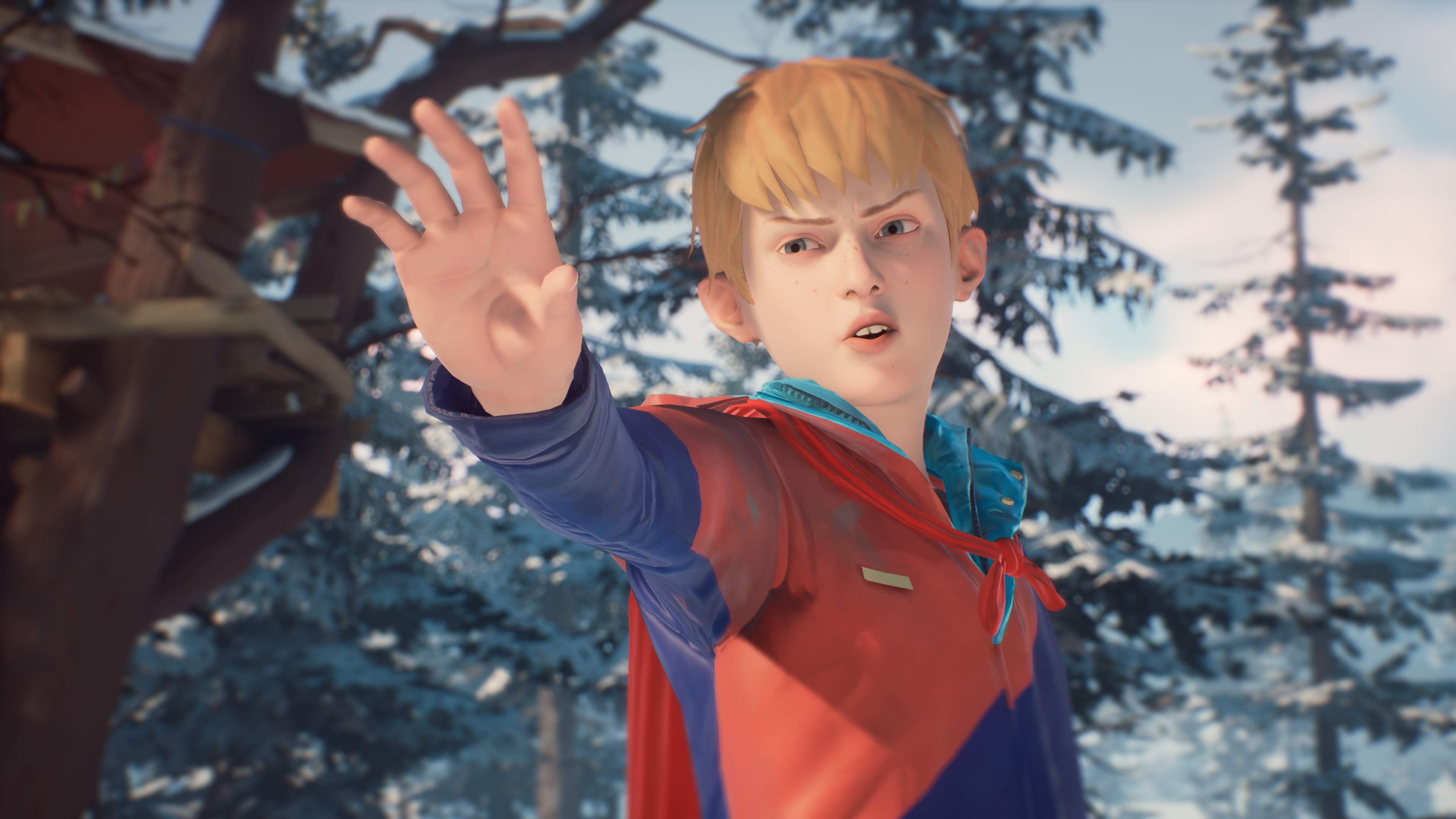 Chris, reaches out his hand in a power pose. He wears a red superhero cape. A snowcapped treehouse is visible behind him.