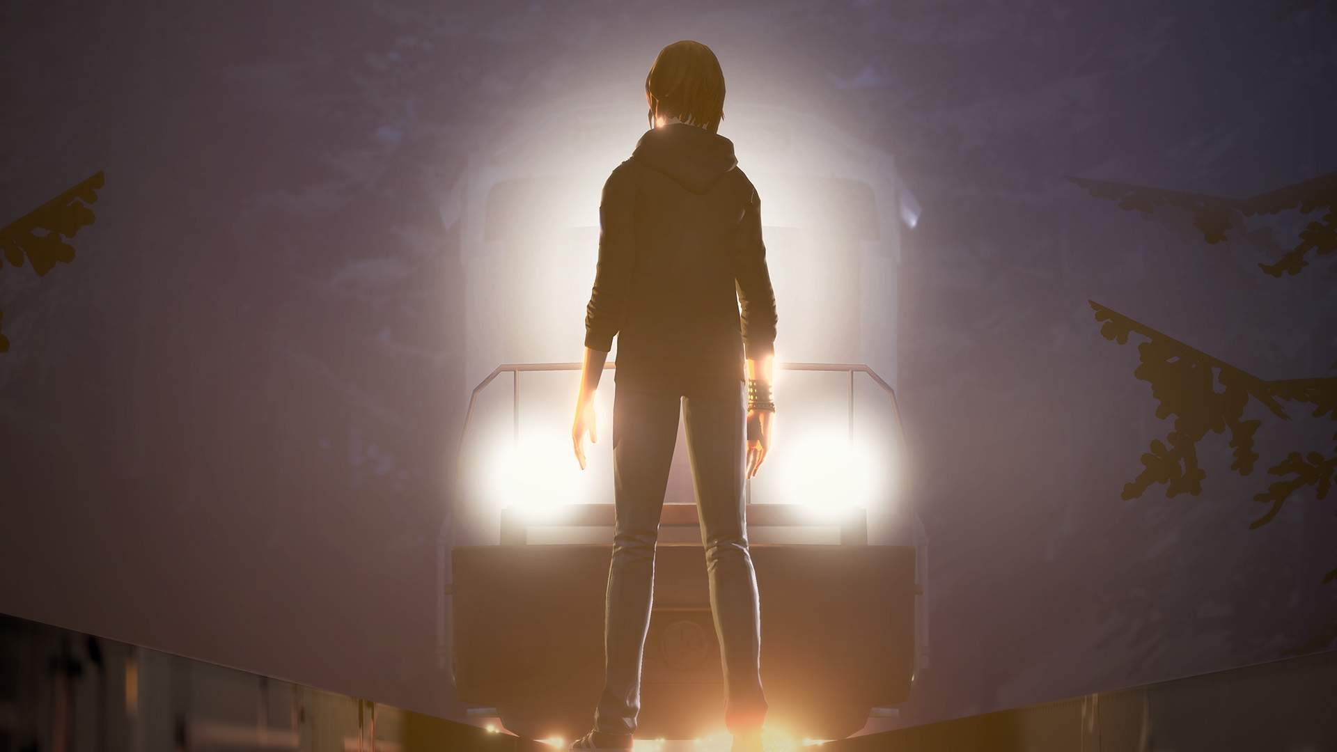 Lit by the headlamps of an oncoming freight train, Chloe Price stands defiant in the middle of the tracks.