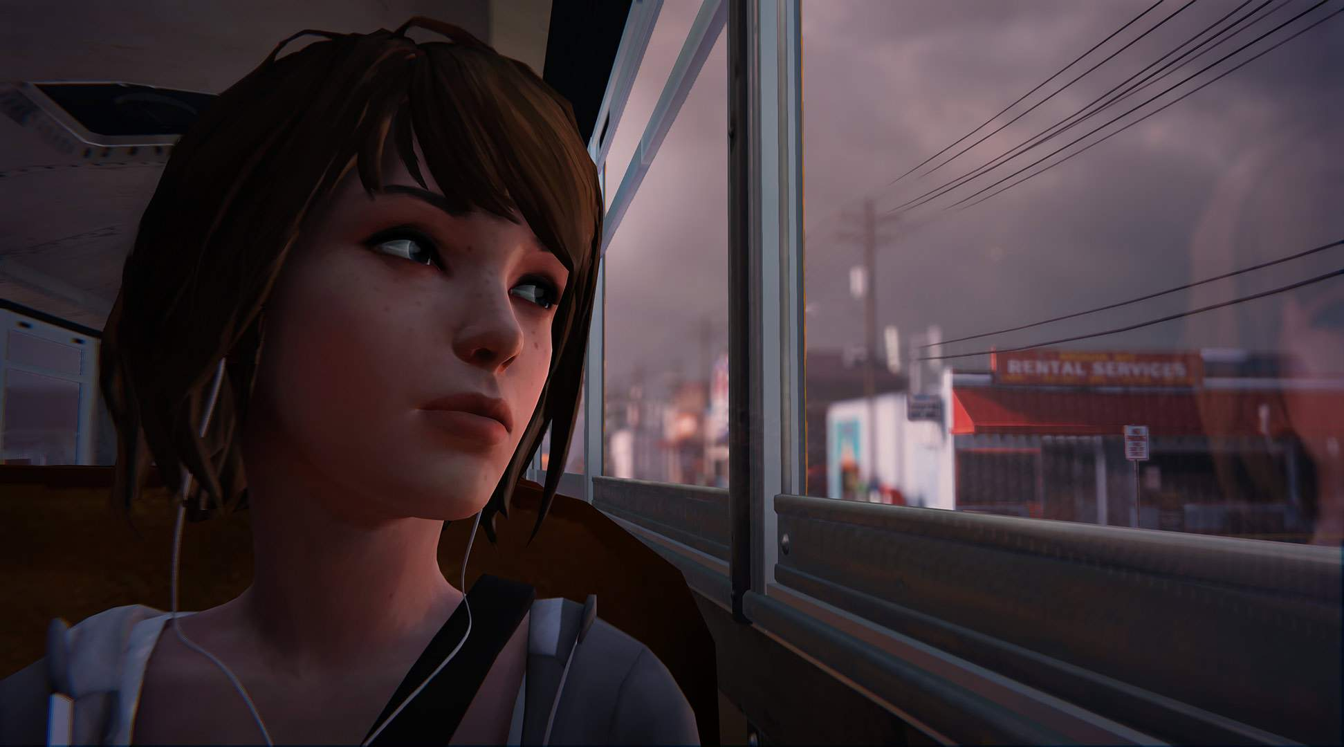 Her headphones in, Max rides the bus through Arcadia Bay, gazing out of the window at the gathering stormclouds.
