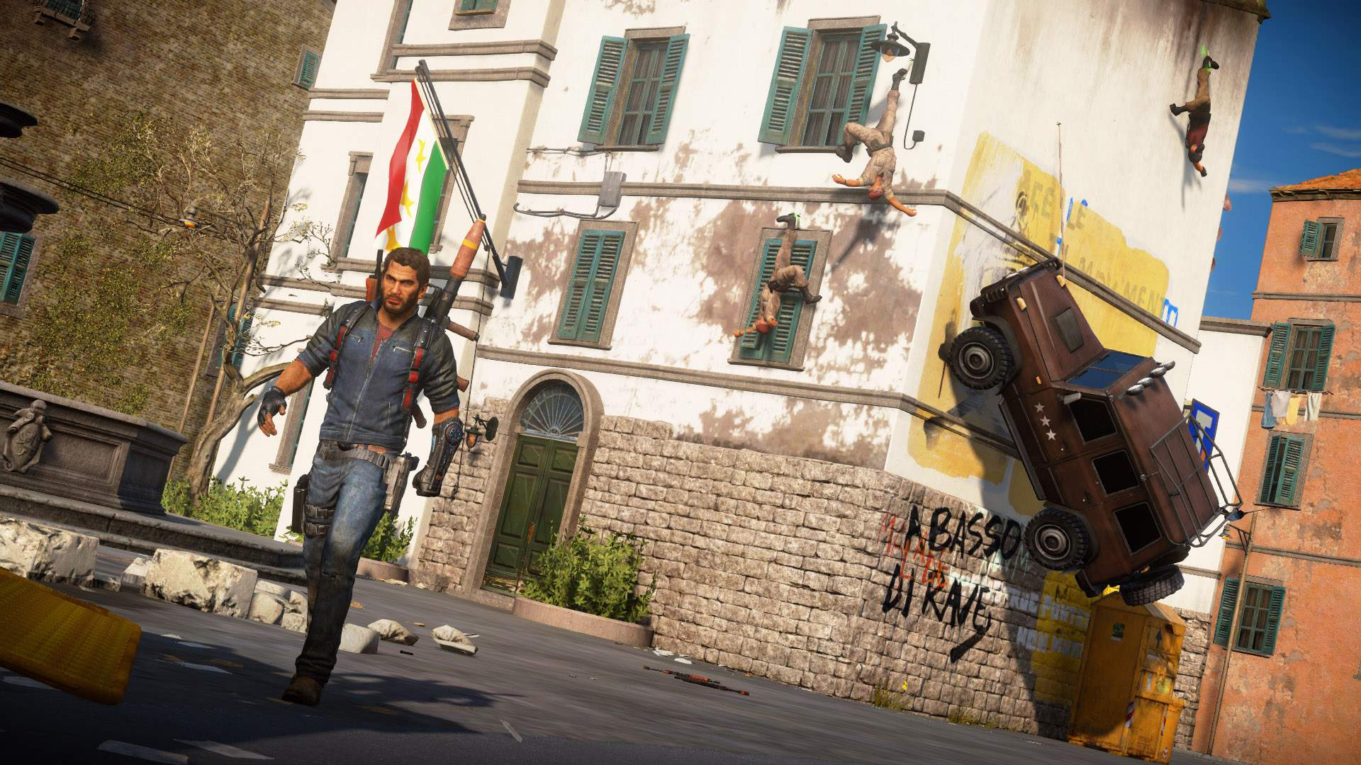 Rico Rodriguez grappling enemies and vehicles to a building